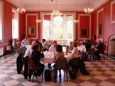 Colloquium delegates enjoying a meal in College Hall, Hereford Cathedral